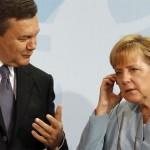 Янукович не потис руку Меркель у Вільнюсі